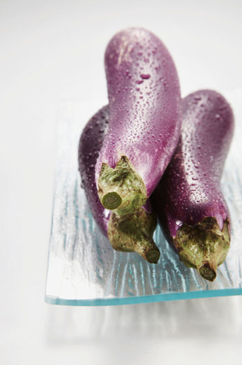 eggplant on the white background Eggplant Freshness Close-up Egg Plant Focus On Foreground Food Food And Drink Fresh Freshness Healthy Eating Indoors  No People Purple Selective Focus Still Life Studio Shot Table Vegetable Waterdrops Wellbeing White Background