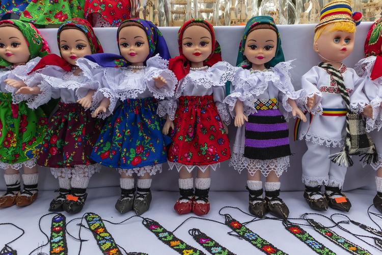 Close-up of dolls at market stall