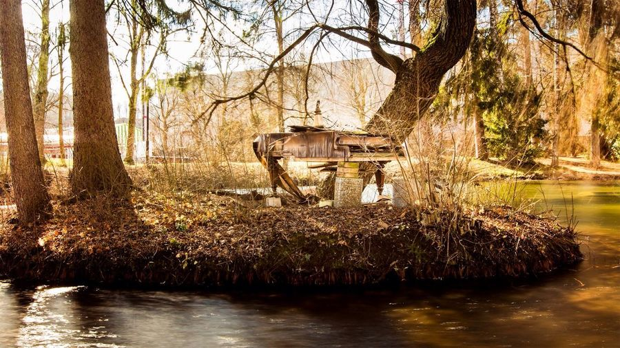 A old piano in the middle Piano Wels Water Photography