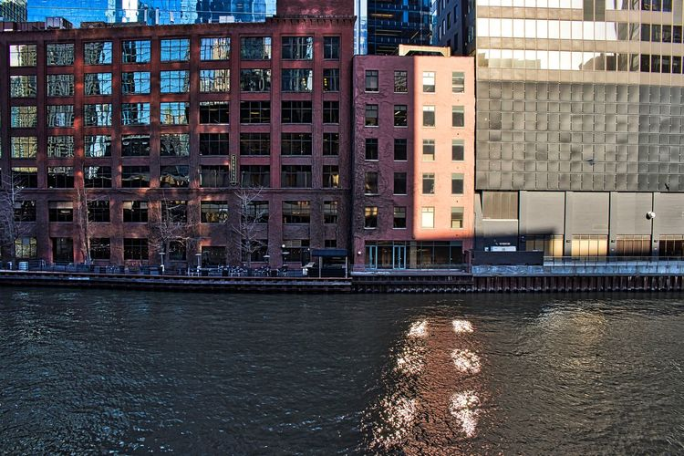 Sunlight shining through building windows reflects pattern onto the Chicago River in the Loop. Waysofseeing Business Chicago Chicago River Chicago Loop Downtown Chicago Light Architecture Building Building Exterior Buildings Built Structure City Colorful Day Effect Nature Outdoors Reflection Rippled River Shadow Travel Destinations Water Waterfront Window The Architect - 2018 EyeEm Awards
