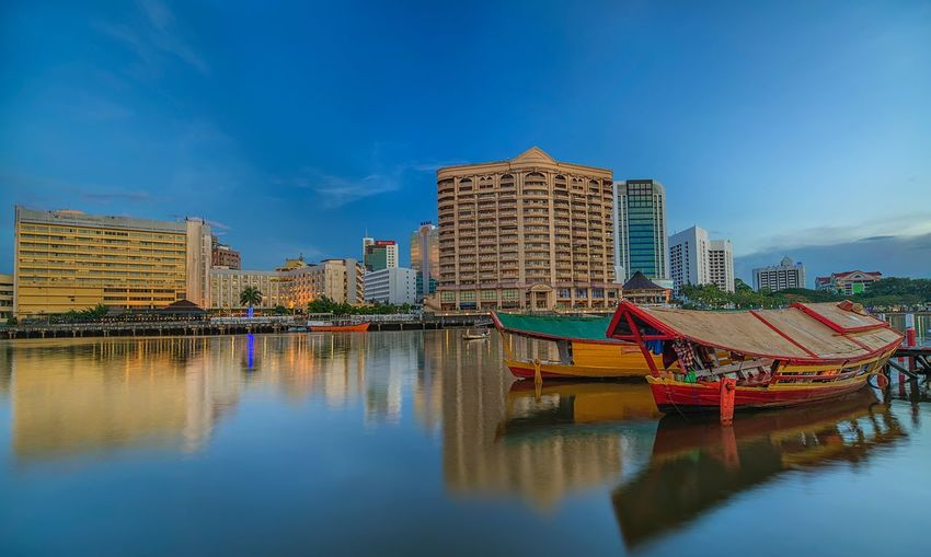 Blue Hour at Sarawak River Water Reflection Architecture Sky Built Structure Building Exterior EyeEmNewHere Waterfront City Building Nature No People River Blue Nautical Vessel Outdoors Transportation Day Travel Destinations Skyscraper
