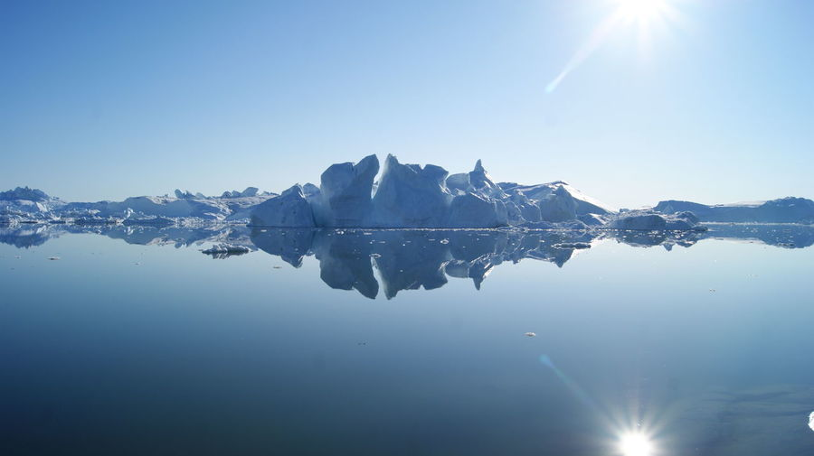 Beauty In Nature Bright Clear Sky Day Greenland Ice IceField Ilulissat Melting Melting Ice Mirror Mirror Reflection Ocean Outdoors Sun Sunny Water White Walking Around Colors Of Nature Cold Temperature Walking Sunny Day