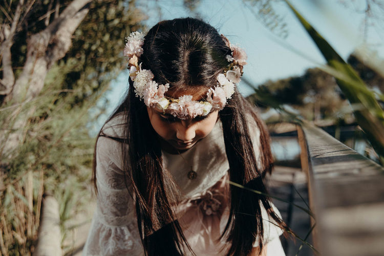 Close-up of girl wearing flower headband