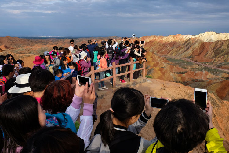 People Photographing Dramatic Landscape At Zhangye Danxia National Geological Park