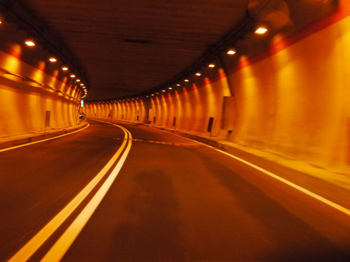 Day Diminishing Perspective Empty Illuminated In A Row Indoors  No People Road The Way Forward Transportation Tunnel Yellow
