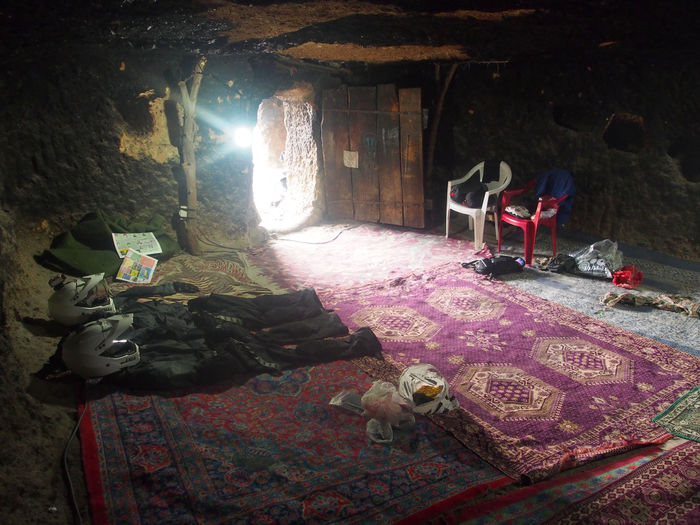 Spendign night at the cave Carpet Cave Cave Hotel Cave Room Daylight Iran Meymand Motorcycle Clothes No People