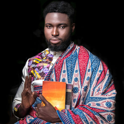 Portrait Ankara Beard Hand Gesture Spirituality Books Black Background Looking At Camera One Person Front View Studio Shot Traditional Clothing