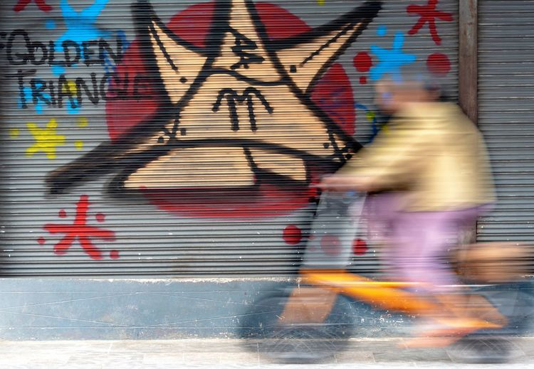 Blurred Motion Motion Graffiti Real People City Walking Architecture Lifestyles Full Length Art And Craft Street Men People Wall - Building Feature Creativity Multi Colored Day on the move Street Art City Life Mural