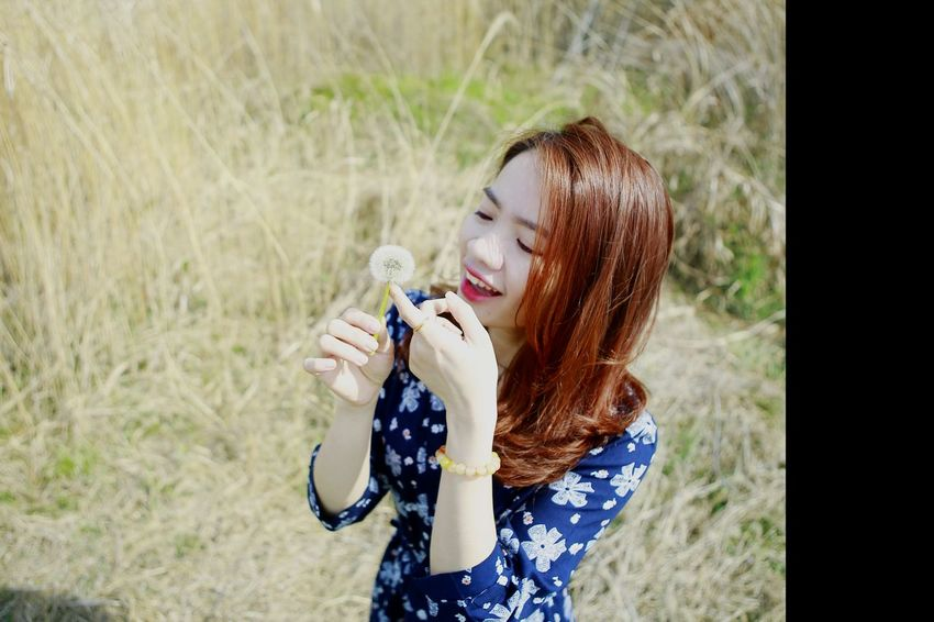 Young Adult Eyes Closed  Outdoors Grass Refreshment Day One Person Leisure Activity People Adults Only Only Women One Young Woman Only Rural Scene Water Happiness Young Women One Woman Only Drinking Water Adult Nature