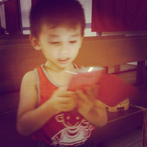 A busy kid with his new gadget hahaha Mycutebro