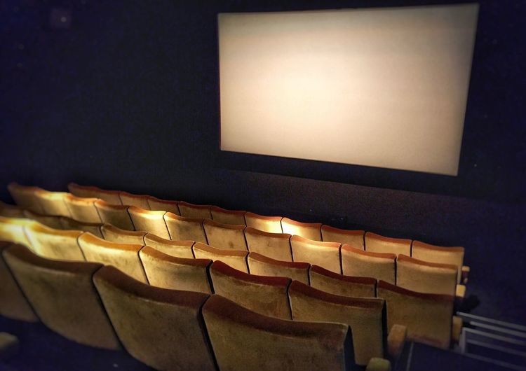 High angle view of empty chairs in theater
