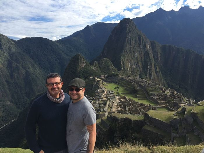 Portrait of smiling friends standing at machu picchu