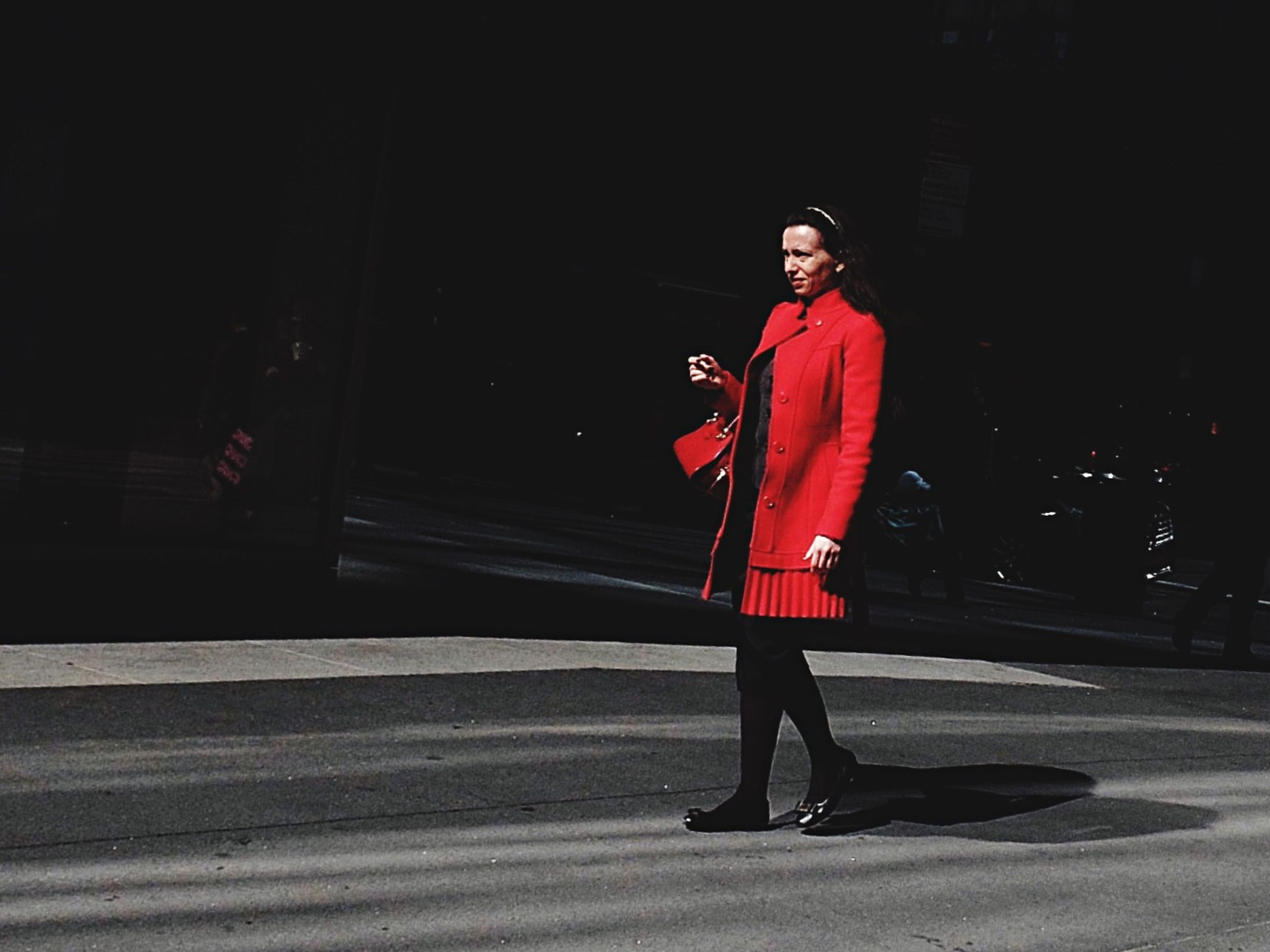 full length, red, walking, street, lifestyles, rear view, night, standing, casual clothing, person, road, leisure activity, men, sidewalk, shadow, front view, outdoors, side view