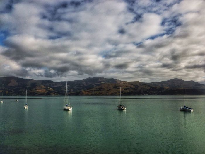 Akaroa New Zealand New Zealand Landscape New Zealand Scenery Stunning Scenery Boats Stunning Skies Eye4photography  EyeEm Best Shots Atmospheric Nature_collection Landscapes Landscape_Collection Clouds & Sky Colours Of Nature EyeEm Best Edits EyeEm Best Shots - Nature EyeEmBestPics EyeEm Boating Lake Hills And Valleys Lakes  Lakeside Lake Colours Of Nature