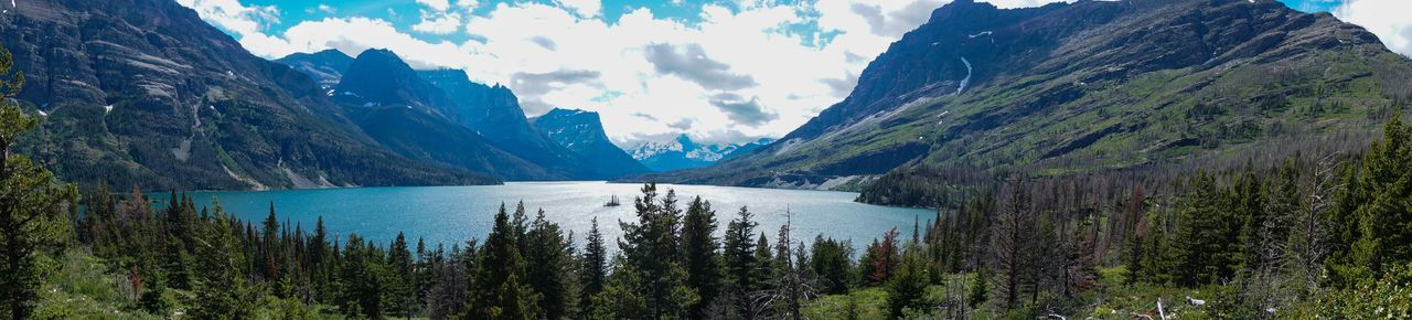 Beauty In Nature Day Environment Formation Glacier National Park Idyllic Lake Lake View Landscape Mountain Mountain Peak Mountain Range Nature Non-urban Scene Panoramic Plant Reflection Scenics - Nature Sky Tranquil Scene Tranquility Water Wilderness