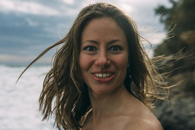 Shirtless Woman At Beach