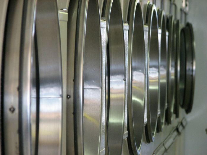 Close-up of washing machines in laundromat