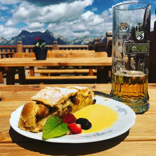 Apple Strudel Dessert Dolomites Dolomites, Italy Drink Drinking Glass Food Food And Drink Forst Forst Beer Indulgence Picnic Table Plate South Tyrol Sweet Food Table