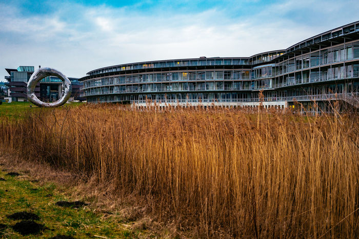 Agriculture Architecture Building Building Exterior Built Structure Clear Sky Composition Connection Crop  Day Engineering Exterior Farm Field Grass Grassy Leading Outdoors Paraplegikerzentrum Perspective Rural Scene Sky Urban