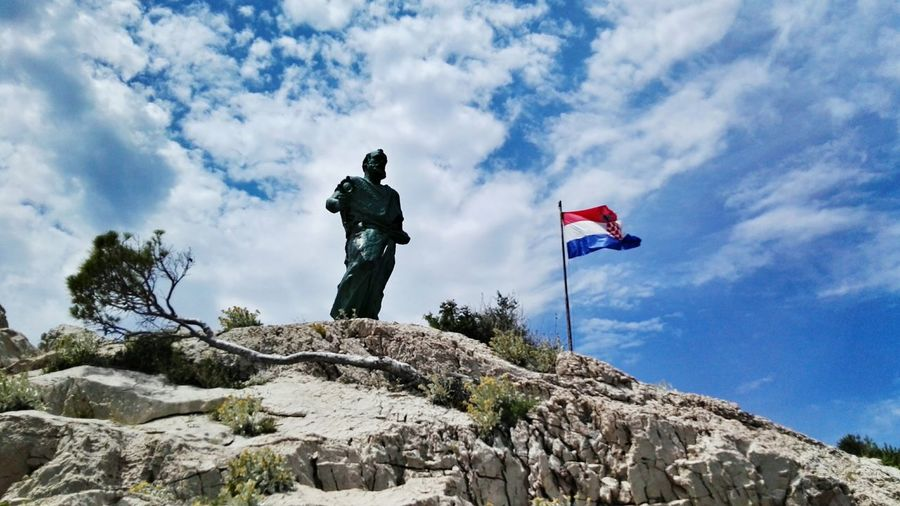 Saint Peter Sveti Petar Statue Flag Landscape Plant Mountain From My Point Of View Croatia Makarska The Essence Of Summer Sky And Clouds Clouds Sunny Landscape_Collection Holidays In Croatia Summer Holiday Nature Rock Rock - Object Plants 🌱 Statues Sky Blue Sky