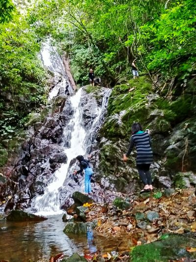 Real People Beauty In Nature Water Nature Rock - Object Day Outdoors Adventure Leisure Activity River Forest Motion Waterfall Tree Scenics Two People Lifestyles Full Length Men People