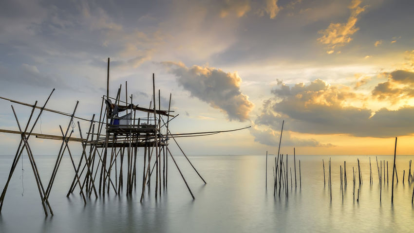 Image of traditional fishermen timber and bamboo jetty known as LANGGAI during sunset Bamboo Jetty Beauty In Nature Cloud Cloud - Sky Fishing Jetty Horizon Over Water Lake Long Exposure Nature Nautical Vessel Non-urban Scene S Scenics Sea Seascape Silhouette Sky Sky And Clouds Sunset Timber Jetty Traditional Jetty Tranquil Scene Tranquility Transportation Water