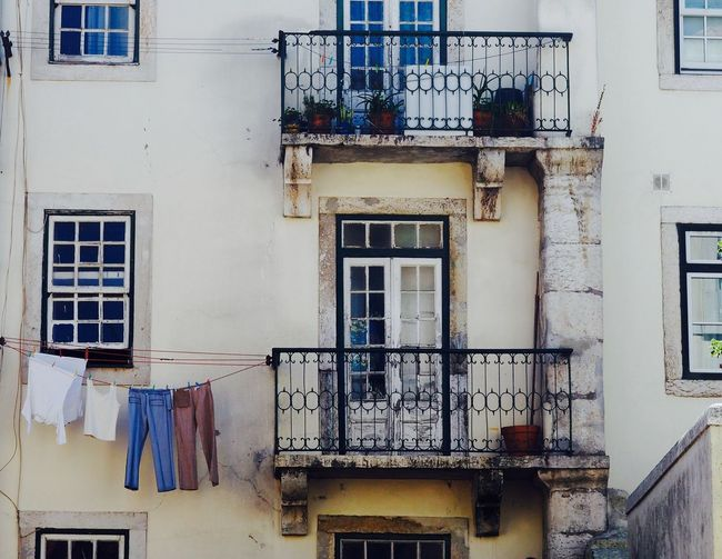 Clothes Drying On Balcony Of House