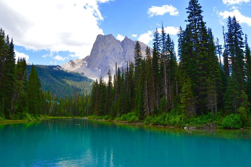 Scenic View Of Emerald Lake Against Mountains