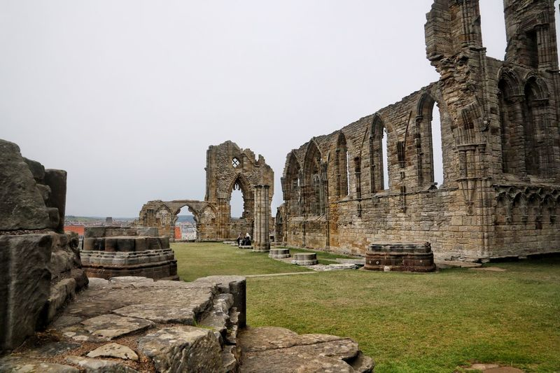 Whitby Whitby Whitby Abbey History The Past Architecture Built Structure Ancient Sky Old Ruin Old Grass Nature Travel Destinations Building Exterior Travel Copy Space No People Ancient Civilization Tourism Day Clear Sky Building Outdoors Archaeology Ruined Abbey Ancient History