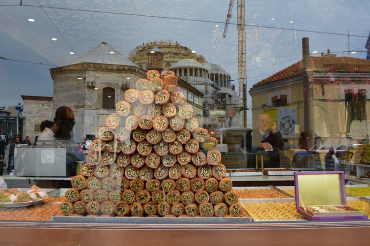 Turkish Food Abundance Architecture Baklava Building Exterior Built Structure Business City Day Food Food And Drink For Sale Freshness Group Of People Incidental People Kadayif Large Group Of Objects Market Market Stall Real People Retail  Retail Display Stack Transparent Turkish Dessert The Traveler - 2018 EyeEm Awards