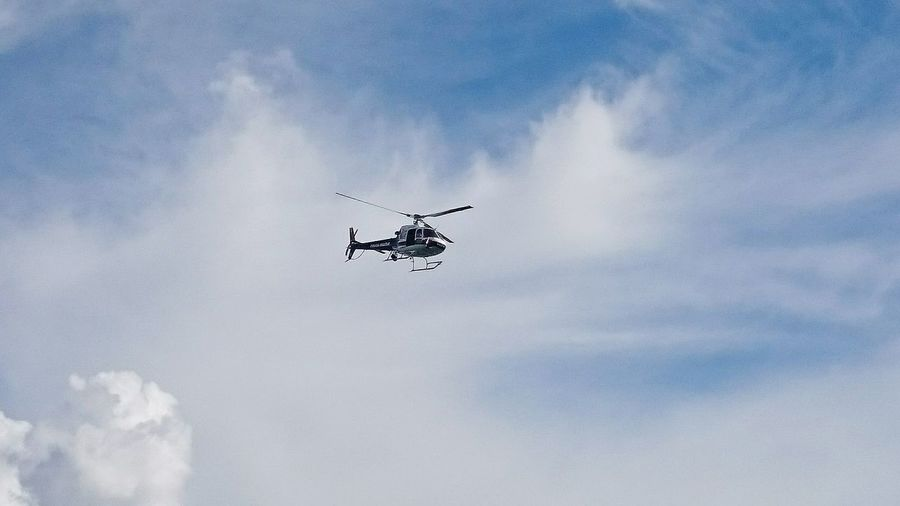 Low angle view of helicopter against the sky