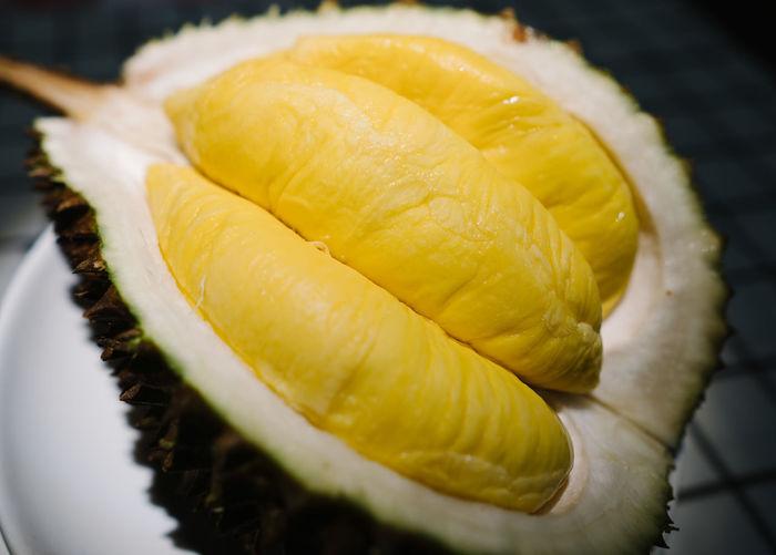 Durian Food Freshness Close-up Food And Drink Healthy Eating Still Life No People Wellbeing Yellow Indoors  Fruit Selective Focus SLICE Focus On Foreground Vegetable Ready-to-eat High Angle View Tropical Fruit Table Plate Temptation Durian