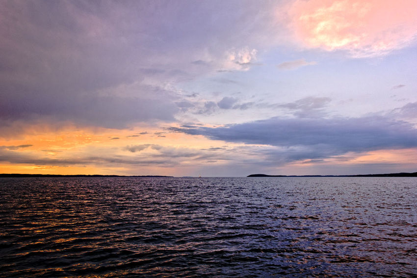 Atmosphere Atmospheric Mood Beauty In Nature Cloud Cloudy Horizon Over Water Light Majestic Orange Color Outdoors Scenics Sea Sky Sunset Tranquil Scene Water
