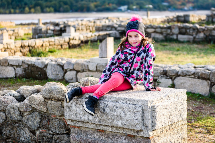 Girl is sitting on remains of ancient roman ruins stone. Children and family vacation - discovering ruins of the ancient Roman settlement Aquis Querquennis in Galicia, Spain. Aquis Querquennis Ruins Roman Ruins Roman Girl Girls Ancient Ancient Roman SPAIN Galicia Ourense Roman Settlement Outside History Landmark Historical Place People Stones Remains Roman Camp Vacations Traveling Hiking Active Outdoors Leisure Activity