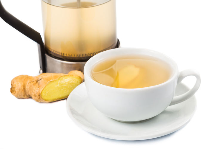 Refreshing and healthy ginger drinks Ginger Tea Tea Breakfast Close-up Coffee Coffee Cup Cup Drink Food Food And Drink Freshness Ginger Hot Drink Indoors  Mug No People Refreshing Refreshment Snack Still Life Studio Shot Tea Tea - Hot Drink Tea Cup White Background