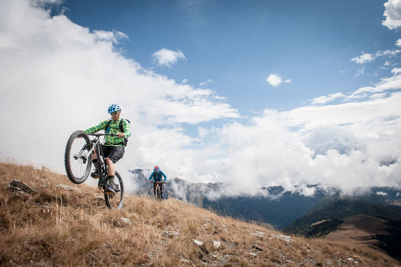 Riding through the Caucasus Range in Georgia Adventure Mountain Sport Leisure Activity Helmet Transportation Men Sky Nature Headwear Ride Riding Bicycle People Activity Real People Sports Clothing Mountain Bike Beauty In Nature Mountain Range Outdoors