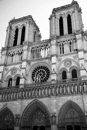 Notre Dame De Paris Historical Building Touristic Attraction EyeEm Best Shots - Black + White Blackandwhite Architecture Building Exterior Built Structure Building Arch Sky Place Of Worship Religion Spirituality Low Angle View Travel Destinations The Past History Travel City Day Nature Outdoors No People Belief