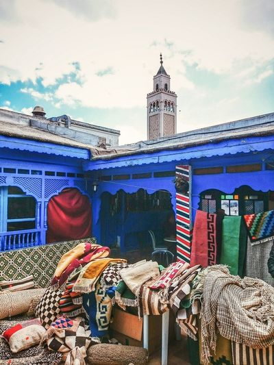 Clothes on table by mosque