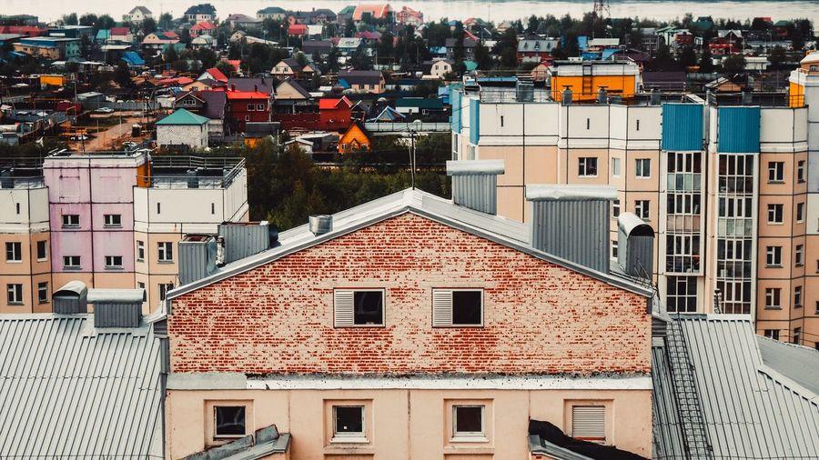 Houses in town against sky