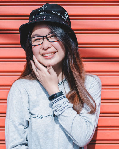 Red Red Background Smiling Portrait Glasses Front View Lifestyles One Person Young Adult Real People Happiness Hair Casual Clothing Leisure Activity Looking At Camera Adult Standing Long Hair Teeth Young Women Eyeglasses  Beautiful Woman Hairstyle