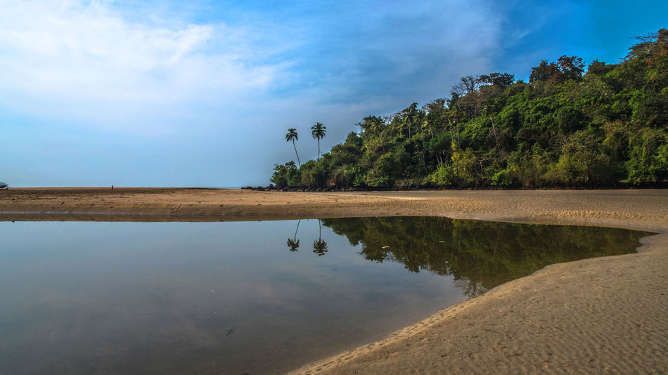 Water Reflection Sky Tranquility Cloud Blue Calm Tranquil Scene Nature Waterfront Scenics Standing Water Solitude Cloud - Sky Beauty In Nature Surface Level Cloudy Outdoors Day Beach Goa Indian Wallart Artforsale Amazing View