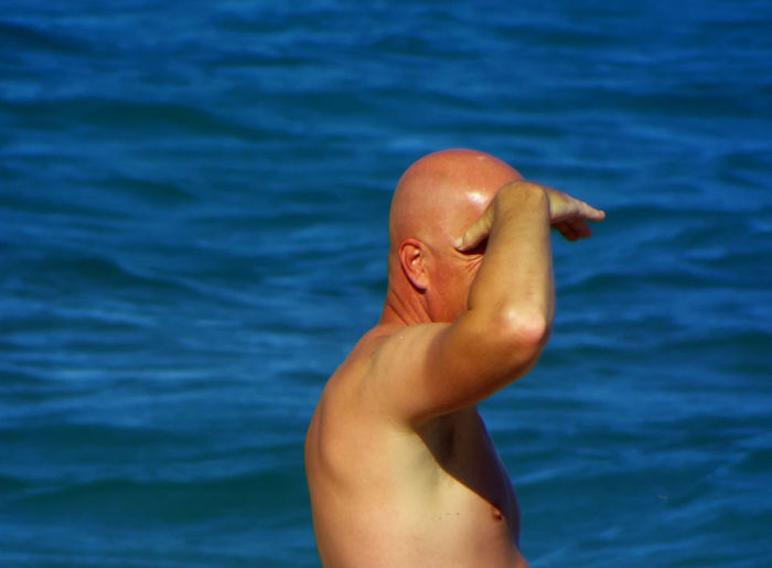 Bald Man Baldness Beach Photography Beauty In Nature Blue Close-up Cropped Day Focus On Foreground Human Finger Leisure Activity Lifestyles Nature Ocean Outdoors Part Of Person Personal Perspective Rippled Sea Tranquility Unrecognizable Person Vacations Fine Art Photography