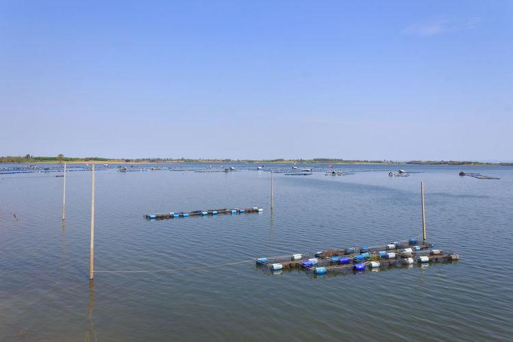 High angle view of boats in sea against clear sky