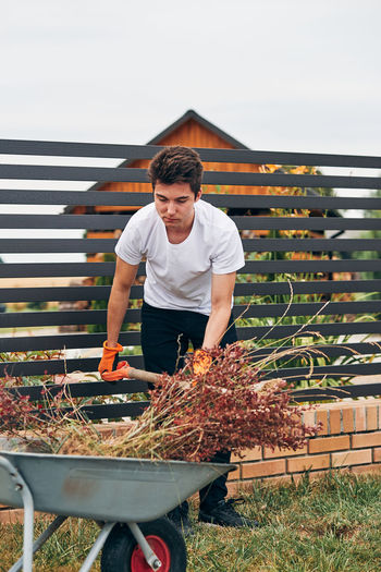 Young man working in yard
