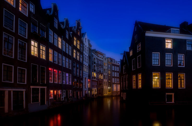 Amsterdam Remo SCarfo Blue Hour Dutch EyeEm Best Shots EyeEmNewHere Building Exterior Architecture Built Structure Building Night Illuminated Sky City Dusk Reflection Window Residential District Blue No People Nature Outdoors House Waterfront Water Canal Row House Apartment