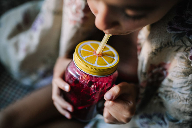 Teenager boy drinking juice at home