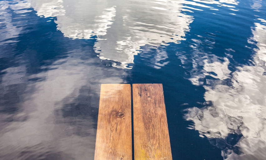 Board Close-up Clouds And Sky Day Dead End End Infinity Lake Landing Stage Nature No People Outdoors Path Reflection Swimming Swimming Pool Synchronicity Timber Water Waves Wood - Material Wood Paneling