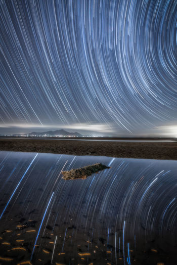 Astronomy Beauty In Nature Blurred Motion Clear Sky Constellation Horizon Over Water Illuminated Light Trail Long Exposure Motion Nature Night No People Outdoors Scenics Sky Space Star - Space Star Trail