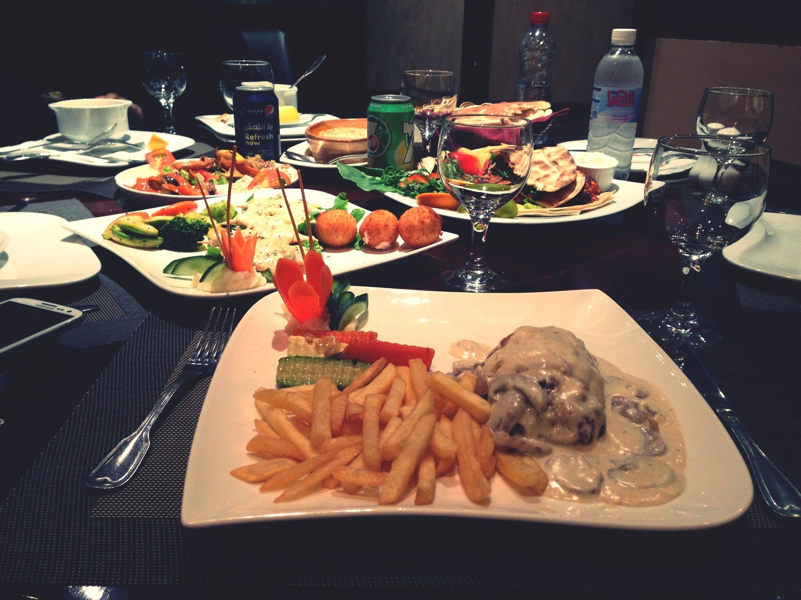 indoors, food and drink, food, freshness, table, still life, plate, healthy eating, ready-to-eat, high angle view, fork, meal, vegetable, variation, restaurant, meat, close-up, serving size, salad, no people