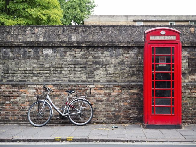 A bicycle against the wall and a telephone booth in Cambridge, UK Brick Wall Leading Lines Lines Telephone Box The Week On EyeEm Transportation Urban Lifestyle Wall Bicycle Bricks Built Structure City Communication Day No People Outdoors Parallel Pay Phone Red Street Telephone Telephone Booth Town Urban Colour Your Horizn